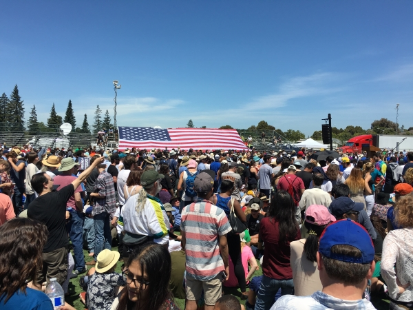 A large crowd waits for Bernie Sanders to talk at ...