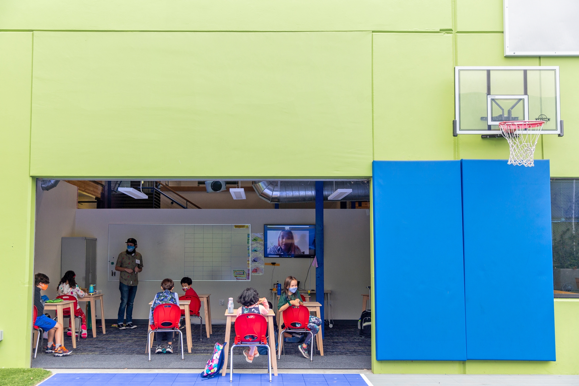Air hugs and weekly testing: Inside one private school's first day back at school