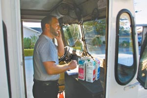 milkman jpg michal chats a customer on his cell phone while making deliveries the energetic milkman loves to talk customers friends and anyone who will